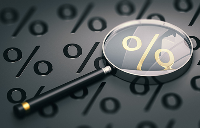 3d illustration of a magnifying glass comparing mortgage rates
